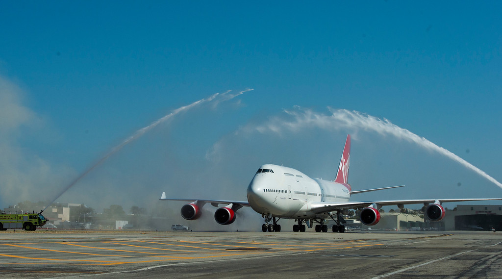 . Virgin Orbit\'s specialized 747, Cosmic Girl, receives a water canon salute as it pulls into LGB in Long Beach Monday, July 31, 2017. The jet is modified to carry space-launch vehicles over the ocean to be fired into orbit.(Photo by Thomas R. Cordova, Press-Telegram/SCNG)