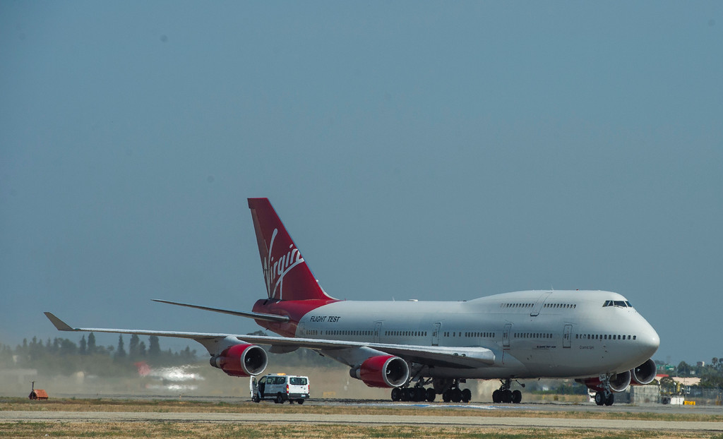 . Virgin Orbit\'s specialized 747, Cosmic Girl, flys into LGB in Long Beach  Monday, July 31, 2017. The jet is modified to carry space-launch vehicles over the ocean to be fired into orbit.(Photo by Thomas R. Cordova, Press-Telegram/SCNG)
