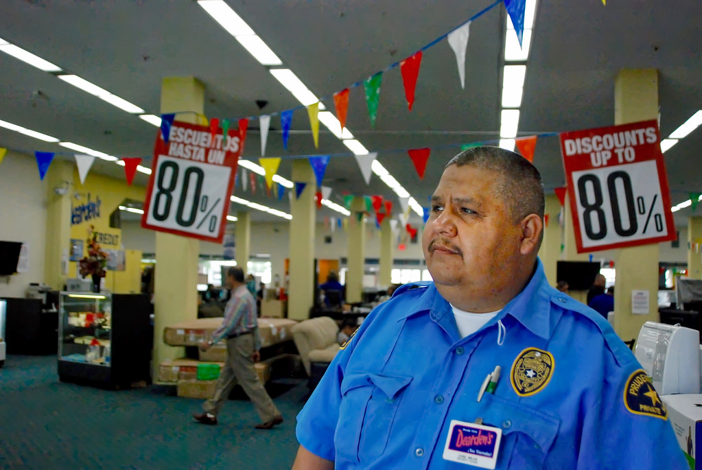 . Jose Mejia, 42, keeps watch at the Dearden\'s home furnishings store on Van Nuys Boulevard in Van Nuys Wednesday, August 2, 2017. Mejia, who has worked security there for six years, said he will be sad to see the store go when it closes for good on Sunday.  (Photo by Matthew Carey)