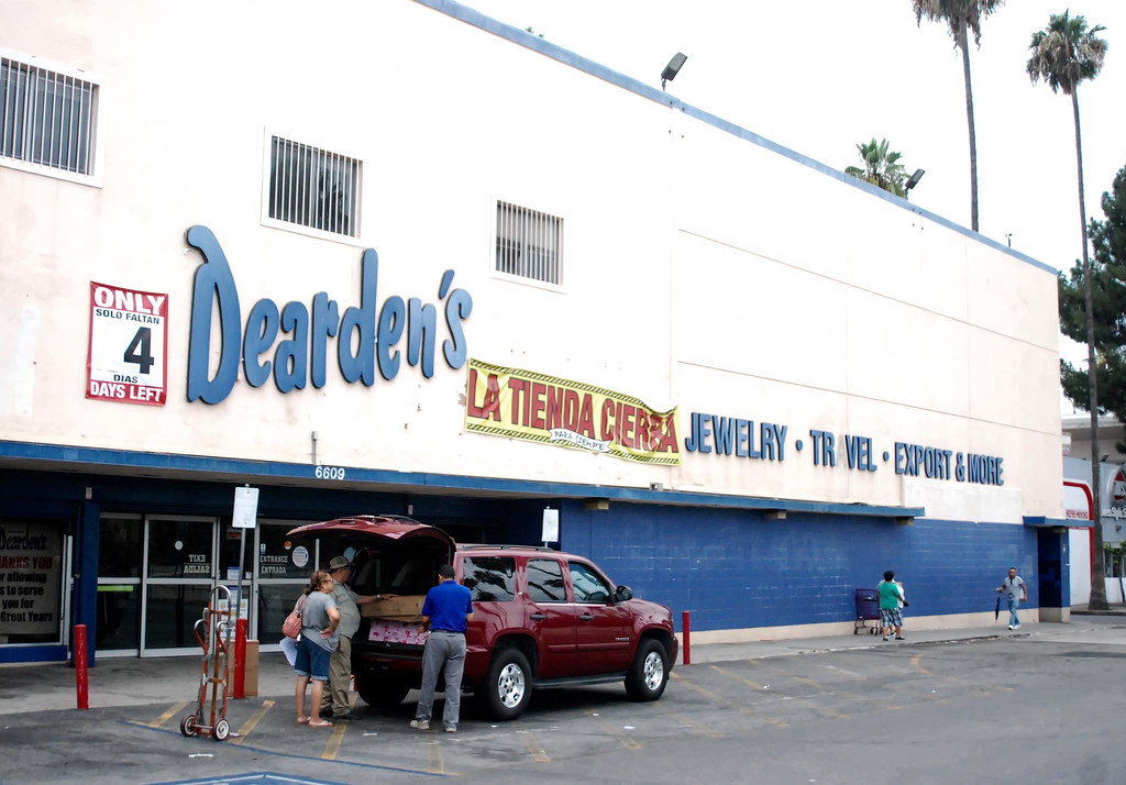 . Customers take home bargains from Dearden\'s on Van Nuys Boulevard in Van Nuys on Wednesday, August 2, 2017. The home furnishings store, which has been in business since 1909, is shuttering the last of its remaining locations, including the Van Nuys store.  (Photo by Matthew Carey)