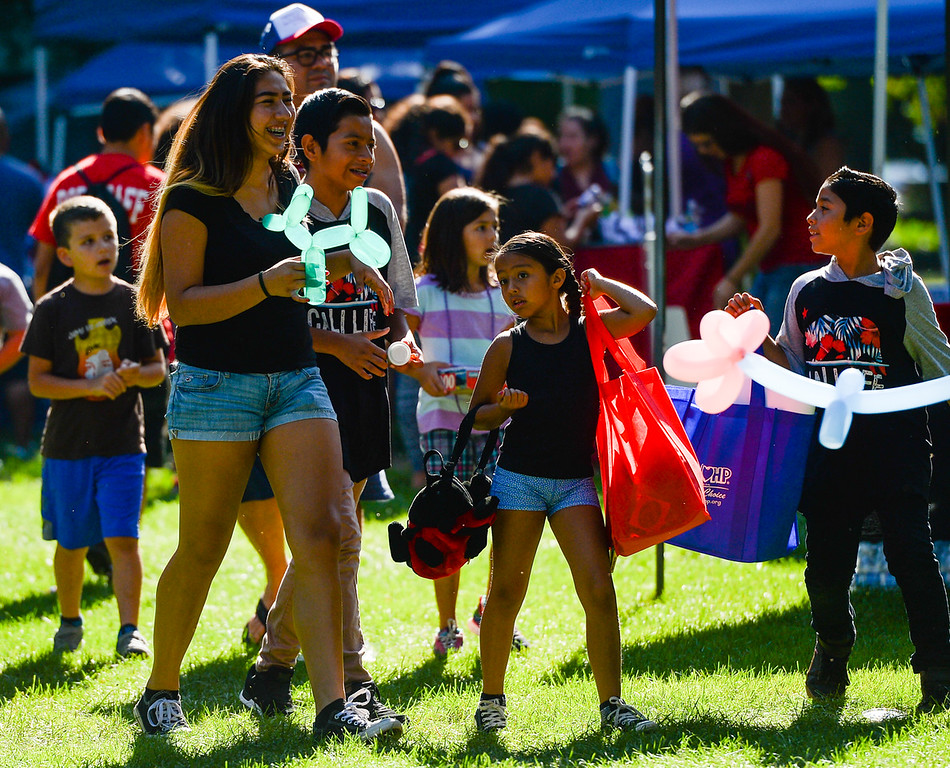 . Children and families enjoy the annual Back2School Jam and Community Resource Fair at Sylvan Park in Redlands, Calif. on Saturday, Aug. 5, 2017. The event provided hundreds of low-income students with backpacks and school supplies, and families with available resources in their community. (Photo by Rachel Luna, Redlands Daily Facts/SCNG)