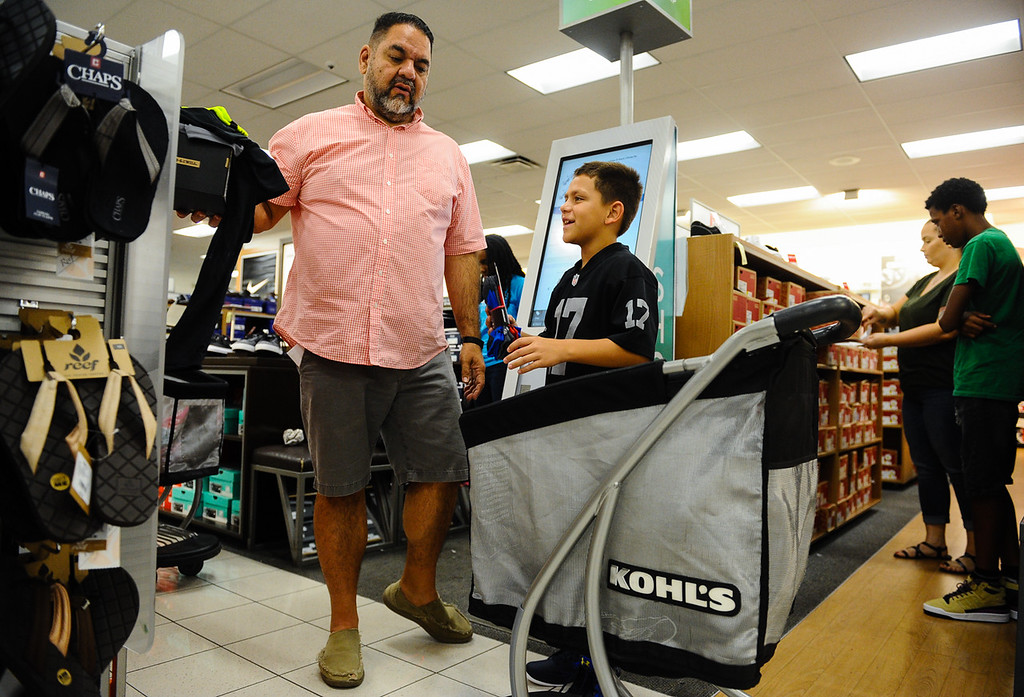 . Brad Barling, 10, shops with volunteer Ray Lozano, of Redlands Elk Lodge 583, during a Boys & Girls Club back-to-school $100 shopping spree at Kohl\'s in Redlands, Calif. on Saturday, Aug. 5, 2017. Local nonprofits and community leaders escorted 122 Boys & Girls Club members around Kohl\'s to help pick out clothes and accessories for the new school year. (Photo by Rachel Luna, The Sun/SCNG)