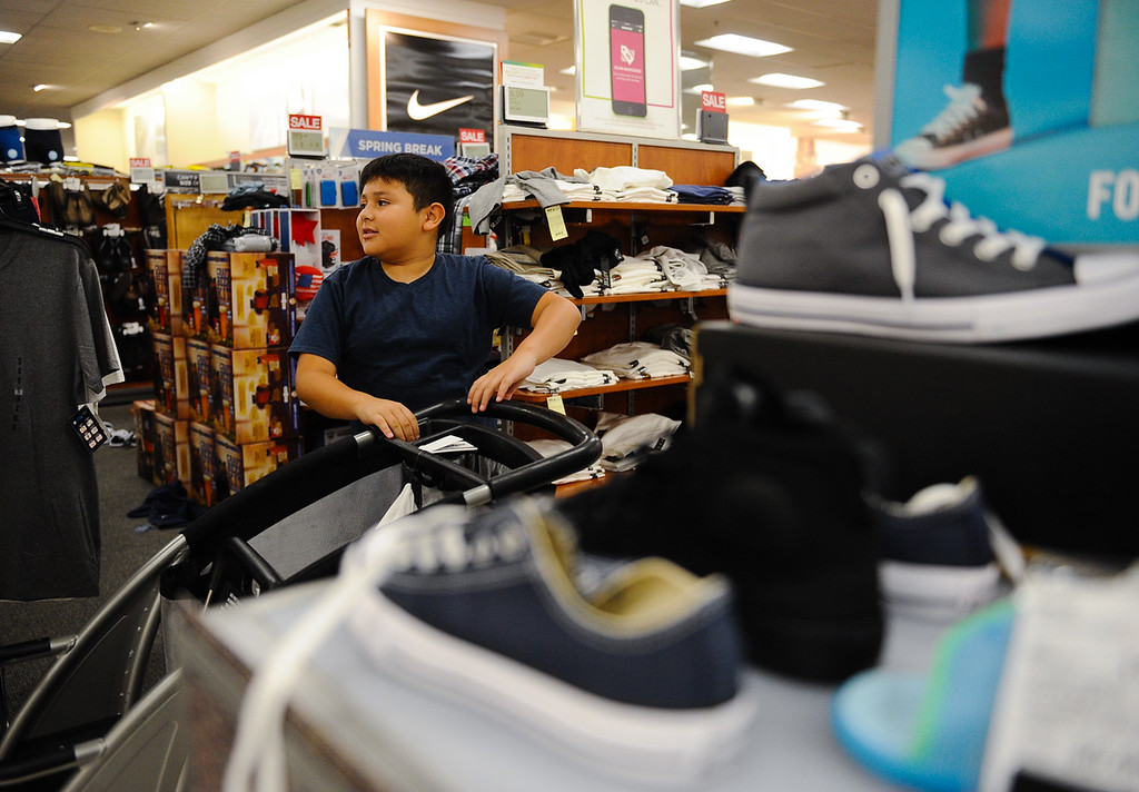 . Julian Degado, 9, shops during a Boys & Girls Club back-to-school $100 shopping spree at Kohl\'s in Redlands, Calif. on Saturday, Aug. 5, 2017. Local nonprofits and community leaders escorted 122 Boys & Girls Club members around Kohl\'s to help pick out clothes and accessories for the new school year. (Photo by Rachel Luna, The Sun/SCNG)
