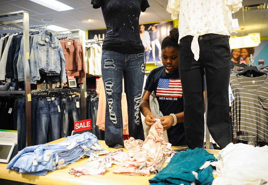 . Janila Gordon, 11, shops during a Boys & Girls Club back-to-school $100 shopping spree at Kohl\'s in Redlands, Calif. on Saturday, Aug. 5, 2017. Local nonprofits and community leaders escorted 122 Boys & Girls Club members around Kohl\'s to help pick out clothes and accessories for the new school year. (Photo by Rachel Luna, The Sun/SCNG)