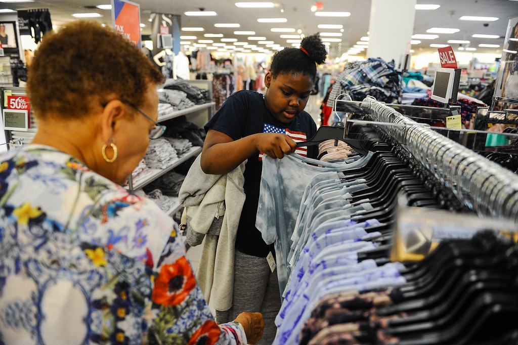 . Janila Gordon, 11, shops with volunteer Gwendolyn Nelson, of Kiwanis Club of San Bernardino, during a Boys & Girls Club back-to-school $100 shopping spree at Kohl\'s in Redlands, Calif. on Saturday, Aug. 5, 2017. Local nonprofits and community leaders escorted 122 Boys & Girls Club members around Kohl\'s to help pick out clothes and accessories for the new school year. (Photo by Rachel Luna, The Sun/SCNG)