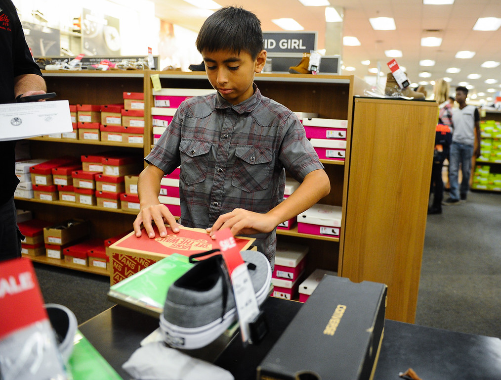 . Anthony Aguilar, 12, picks out new shoes during a Boys & Girls Club back-to-school $100 shopping spree at Kohl\'s in Redlands, Calif. on Saturday, Aug. 5, 2017. Local nonprofits and community leaders escorted 122 Boys & Girls Club members around Kohl\'s to help pick out clothes and accessories for the new school year. (Photo by Rachel Luna, The Sun/SCNG)