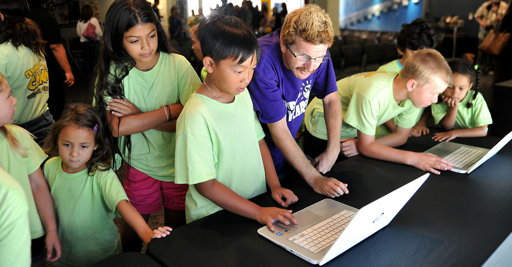 . Students from the Sunrise Child Development Center in Garden Grove use laptops to search images at the Columbia Memorial Space Center in Downey in celebration of their  partnership with the Google Cultural Institute. The partnership makes a selection of images, ranging from space shuttles built when the city was home to vast aerospace manufacturing facilities to their state of the art learning center visited by thousands of students each year, accessible to a global audience. Long Beach August 7, 2014. (Photo by Brittany Murray / Daily Breeze)