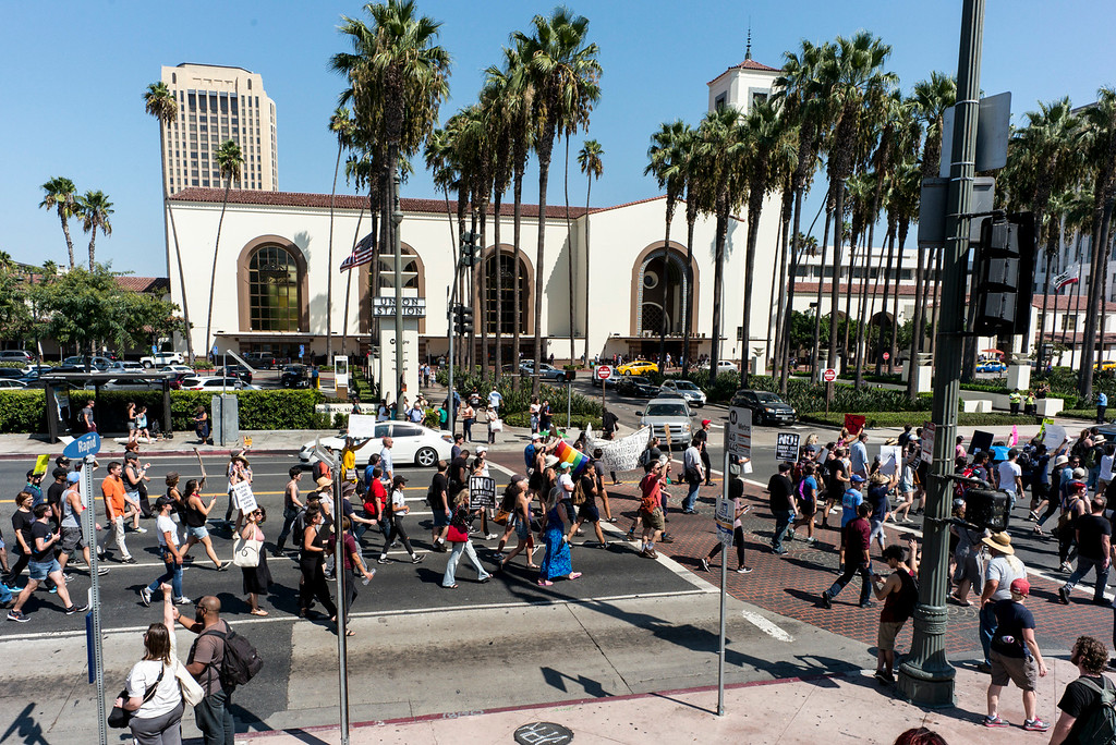 . Marchers pass by Union Station in Los Angeles Sunday.  A rally in Los Angeles drew hundreds to stand in solidarity with Charlottesville and the death of Heather Heyer who was run over by a motorist while participating in an anti-KKK protest.  The group gathered at City Hall then marched to the Metropolitan Detention Center in downtown Los Angeles Sunday, August 13, 2017.   ( Photo by David Crane, Los Angeles Daily News/SCNG)