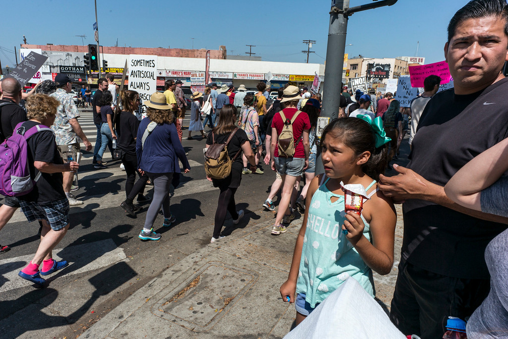 . Visitors to Olivera Street watch as marchers pass by in a rally to stand in solidarity with Charlottesville and the death of Heather Heyer who was run over by a motorist while participating in an anti-KKK protest.  The group gathered at City Hall then marched to the Metropolitan Detention Center in downtown Los Angeles Sunday, August 13, 2017.   ( Photo by David Crane, Los Angeles Daily News/SCNG)