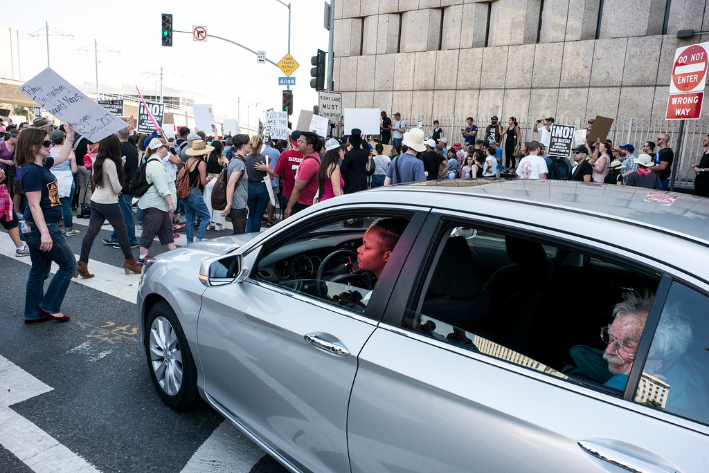 . Motorists get stuck in a march in downtown Los Angeles as marchers took over city streets.  A rally in Los Angeles drew hundreds to stand in solidarity with Charlottesville and the death of Heather Heyer who was run over by a motorist while participating in an anti-KKK protest.  The group gathered at City Hall then marched to the Metropolitan Detention Center in downtown Los Angeles Sunday, August 13, 2017.   ( Photo by David Crane, Los Angeles Daily News/SCNG)