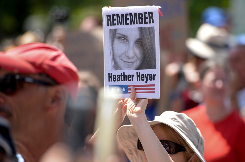 . A marcher holds a sign with a photo of Heather Heyer who was run over by a car in an anti-KKK protest in Charlottesville Saturday.  A rally in Los Angeles drew hundreds to stand in solidarity with Charlottesville.  The group gathered at City Hall then marched to the Metropolitan Detention Center in downtown Los Angeles Sunday, August 13, 2017.   ( Photo by David Crane, Los Angeles Daily News/SCNG)