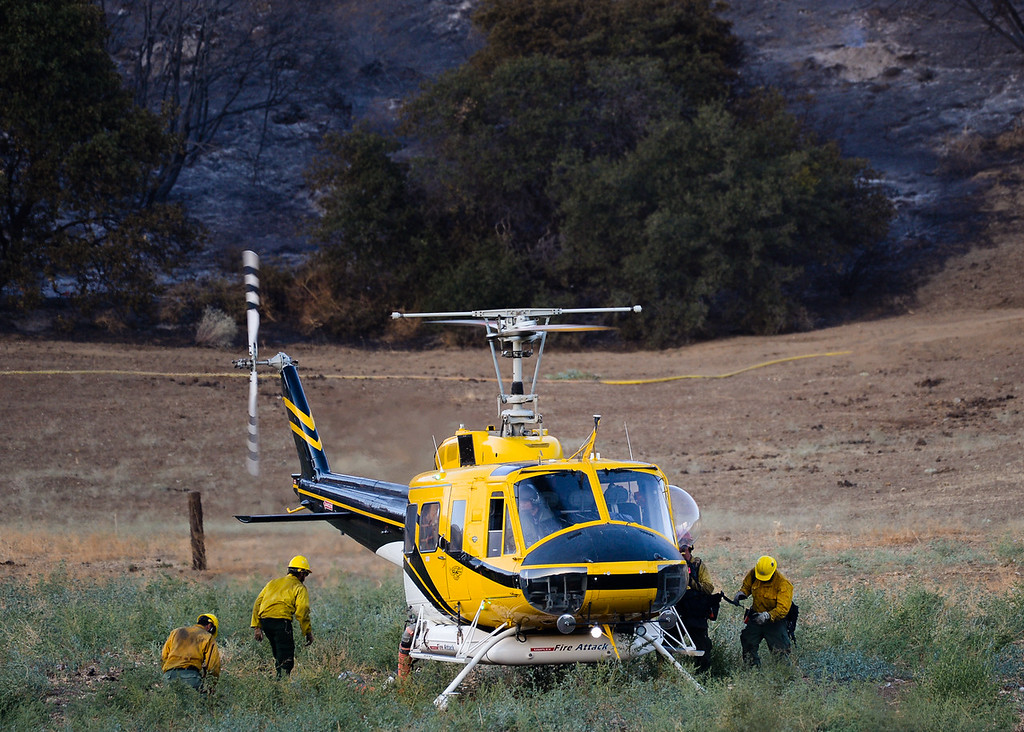 . Firefighters battle the 600 acre Mias Fire in Mias Canyon north of Banning, Calif. on Monday, Aug. 14, 2017. About 255 firefighters, seven air tankers and three water-dropping helicopters fought the fire, which was at five-percent containment Monday evening. (Photo by Rachel Luna, The Press-Enterprise/SCNG)