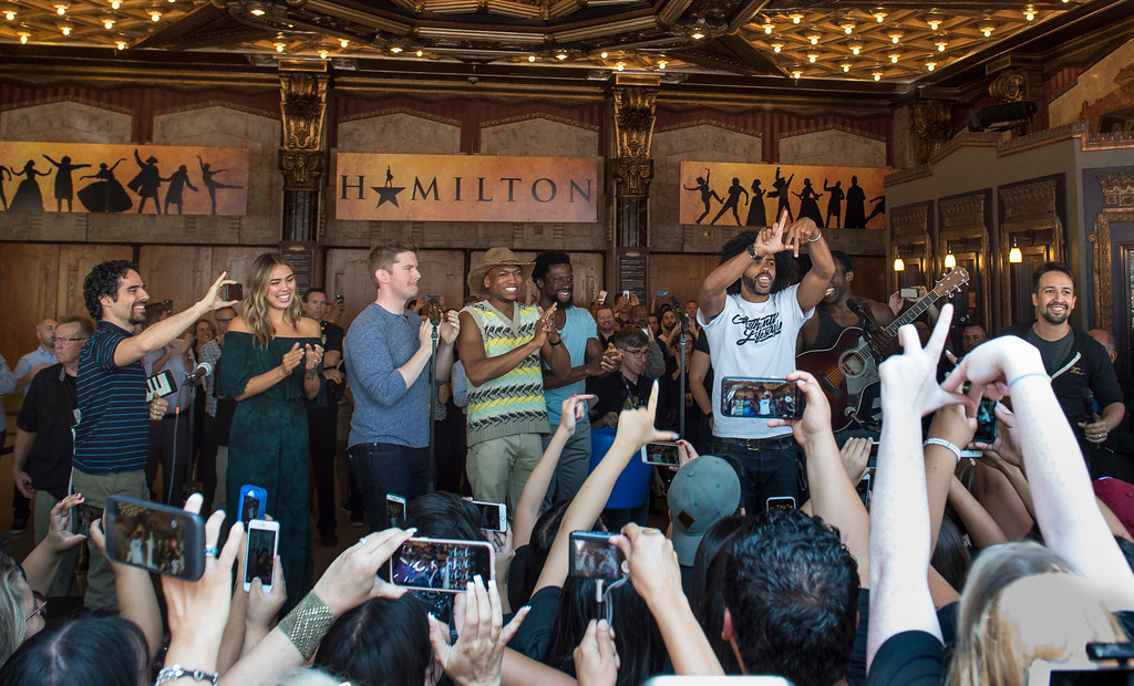 ". Lin-Manuel Miranda, right, ""Hamilton\"" creator, surprise guests and cast members greet fans in front of the Hollywood Pantages Theatre in Hollywood during \""Hamilton\"" ticket lottery on Wednesday, Aug 16, 2017. (Photo by Ed Crisostomo, Los Angeles Daily News/SCNG)"