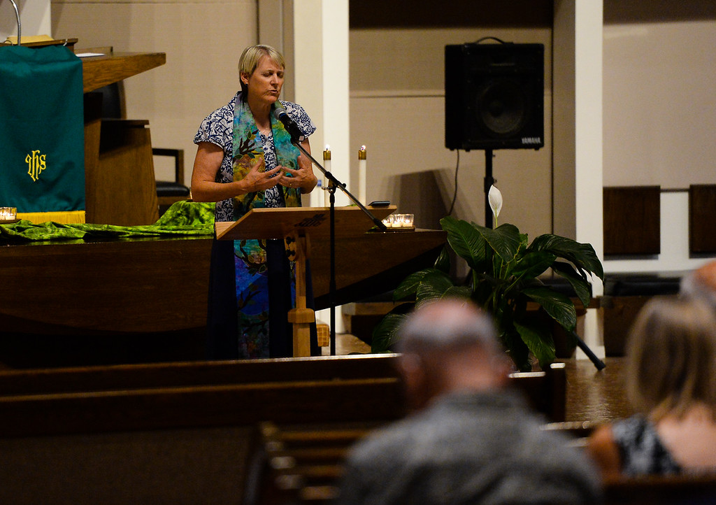 . Rev. Cheryl Raine leads community member in prayers for those affected by the Charlottesville violence during a vigil at the First Presbyterian Church in Redlands, Calif. on Thursday, Aug. 17, 2017. (Photo by Rachel Luna, The Sun/SCNG)Rev