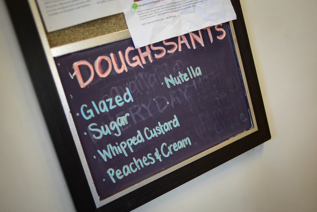 ". Cindy Seam creates ""doughssants\"" in her Spudnuts doughnut shop in Canoga Park.  The latest food fad is made from a combination of doughnuts and croissants with lots of cream and other tasty ingredients.   Photo by David Crane/Los Angeles Daily News."