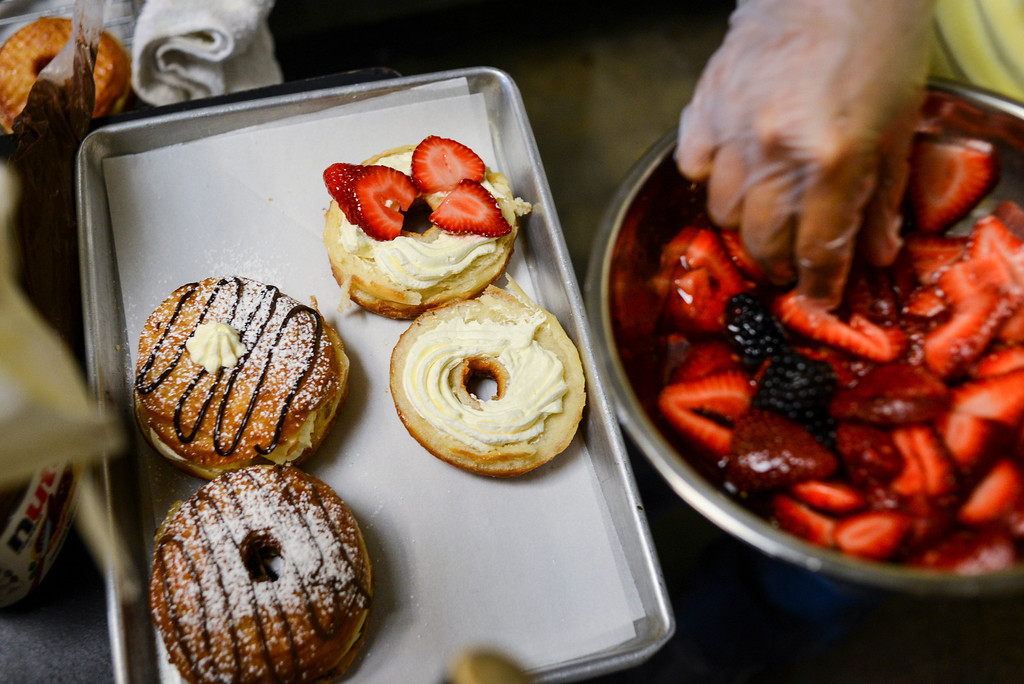 ". Cindy Seam creates her ""doughssants\"" in her Spudnuts doughnut shop in Canoga Park.  The latest food fad is made from a combination of doughnuts and croissants with lots of cream and other tasty ingredients.   Photo by David Crane/Los Angeles Daily News."
