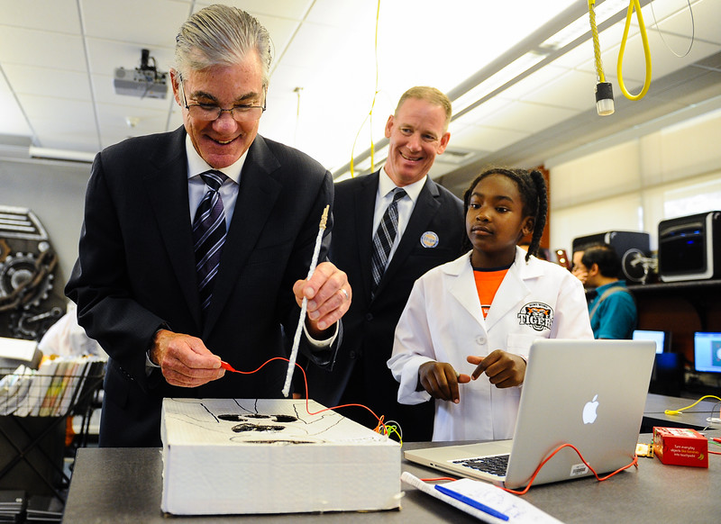 State Superintendent of Public Instruction Tom Torlakson, left, interacts with fourth grader Jaila Jones' project as she watches alongside San Bernardino City Unified Superintendent Dale Marsden, center, during a tour of Bing Wong Elementary School in San Bernardino, Calif. on Friday, Aug. 26, 2016. Torlakson toured to learn more about efforts to expose local students to potential careers starting as early as kindergarten. (Photos by Rachel Luna/The Sun, SCNG)