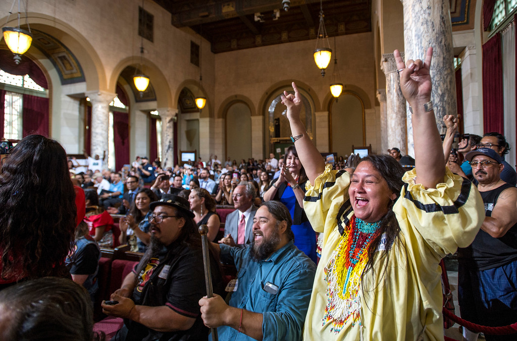 . Tess Potter, right, with the Yavapai-Apache tribe, reacts as the Los Angeles City Council voted 14-1 Wednesday to replace Columbus Day with Indigenous Peoples Day at City Hall in Los Angeles on Wednesday, Aug 30, 2017. (Photo by Ed Crisostomo, Los Angeles Daily News/SCNG)