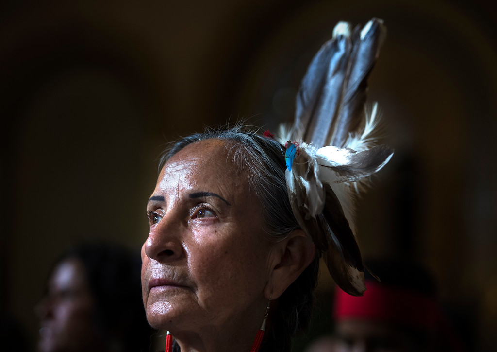 . Patricia Lopez, with the Tiwa/Taos tribe, gazes outward as she joins others in support of Indigenous Peoples Day during a City Council meeting at City Hall in Los Angeles on Wednesday, Aug 30, 2017. Los Angeles City Council voted 14-1 Wednesday to replace Columbus Day with Indigenous Peoples Day. (Photo by Ed Crisostomo, Los Angeles Daily News/SCNG)