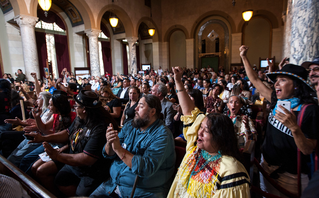 . Tess Potter, second from right, with the Yavapai-Apache tribe, reacts and celebrates with others as the Los Angeles City Council voted 14-1 Wednesday to replace Columbus Day with Indigenous Peoples Day at City Hall in Los Angeles on Wednesday, Aug 30, 2017. (Photo by Ed Crisostomo, Los Angeles Daily News/SCNG)