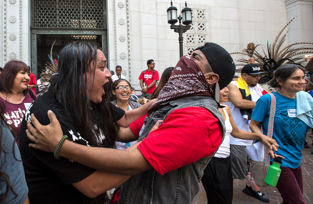 . Lance Browneyes, left, of Santa Ana, with the Lakota tribe, celebrates with others after the Los Angeles City Council voted 14-1 Wednesday to replace Columbus Day with Indigenous Peoples Day at City Hall in Los Angeles on Wednesday, Aug 30, 2017. (Photo by Ed Crisostomo, Los Angeles Daily News/SCNG)