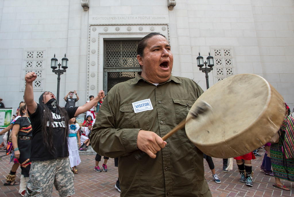 . George Funmaker, right, with the Dakota/Ho-Chunk tribe, and Lance Browneyes, of Santa Ana, with the Lakota tribe, celebrate with others after the Los Angeles City Council voted 14-1 Wednesday to replace Columbus Day with Indigenous Peoples Day at City Hall in Los Angeles on Wednesday, Aug 30, 2017. (Photo by Ed Crisostomo, Los Angeles Daily News/SCNG)