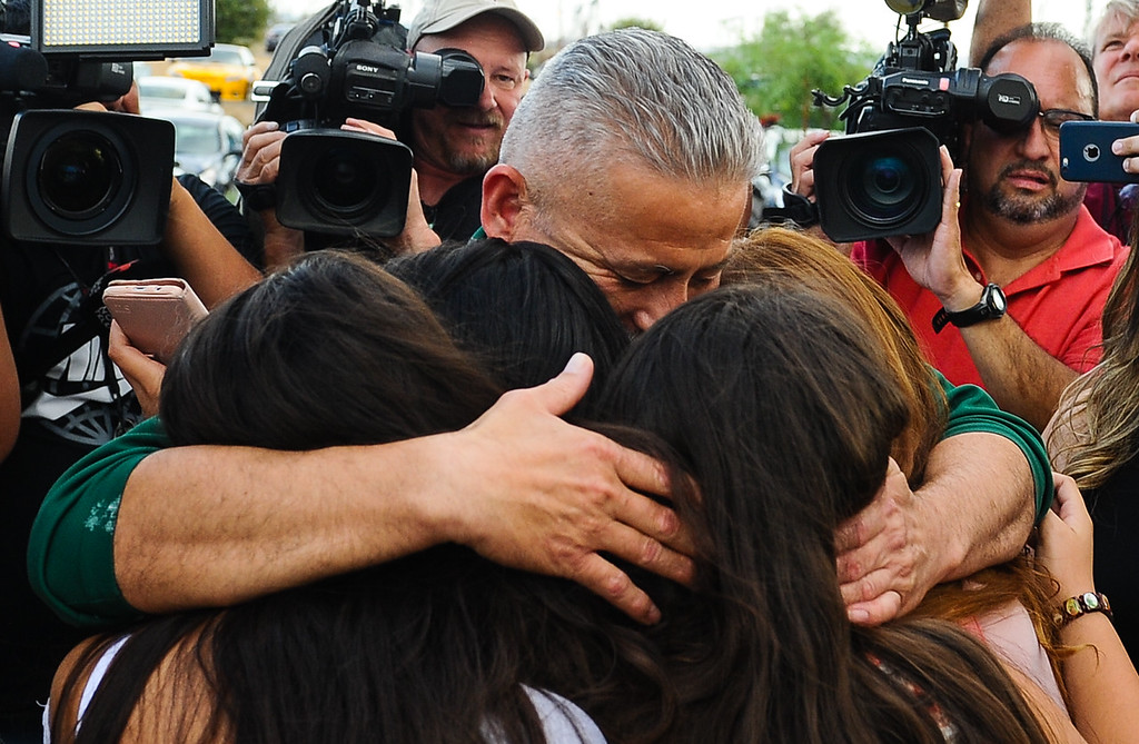. Romulo Avelica-Gonzalez, a 49-year-old father of four who arrested by immigration authorities on Feb. 28 shortly after dropping off one of his daughters at school, embraces his daughters upon being released from the GEO Desert View Immigration Detention Center in Adelanto, Calif. on Wednesday, Aug. 30, 2017. The decision to allow the Lincoln Heights resident to post bond does not mean the end to his possible deportation, but it will allow him to return to his family while his case proceeds. (Photo by Rachel Luna, Los Angeles Daily News/SCNG)