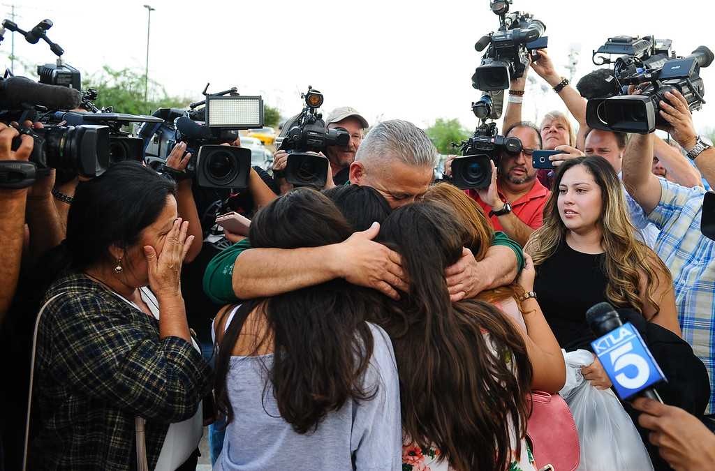 . Surrounded by family and the media, Romulo Avelica-Gonzalez, a 49-year-old father of four who arrested by immigration authorities on Feb. 28 shortly after dropping off one of his daughters at school, embraces his daughters upon being released from the GEO Desert View Immigration Detention Center in Adelanto, Calif. on Wednesday, Aug. 30, 2017. The decision to allow the Lincoln Heights resident to post bond does not mean the end to his possible deportation, but it will allow him to return to his family while his case proceeds. (Photo by Rachel Luna, Los Angeles Daily News/SCNG)