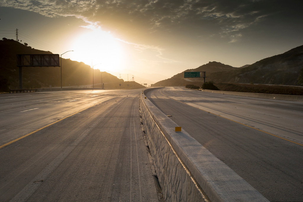 . The sun rises over an empty I-210 Sunday morning as the freeway and many other local streets remain closed while firefighters continue to battle the La Tuna Fire which has now blackened more than 5,800 acres.  Los Angeles mayor Eric Garcetti has declared a local emergency for the fire which has destroyed 3 homes.   ( Photo by David Crane, Los Angeles Daily News/SCNG)
