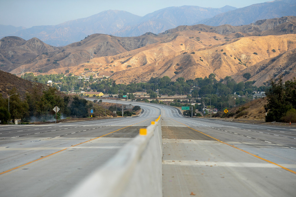 . The I-210 freeway in Los Angeles is completely empty Sunday as the La Tuna fire continues to spread.   Los Angeles mayor Eric Garcetti has declared a local emergency for the fire which has destroyed 3 homes and blackened more than 5,800 acres.   ( Photo by David Crane, Los Angeles Daily News/SCNG)