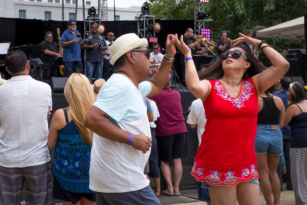 . Crowds dance to the beat of Poncho Shanchez at the Labor Day music fest at Grand Park Monday in downtown LA. ( Photo by David Crane, Los Angeles Daily News/SCNG)