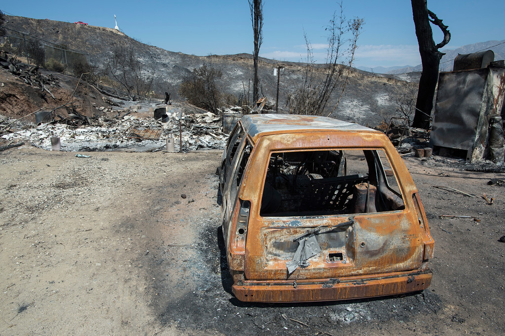 . Destroyed cars and homes sit along the path of the La Tuna Fire on Verdugo Crestline Drive near Tujunga on Tuesday, Sept. 5, 2017. (Photo by Ed Crisostomo, Los Angeles Daily News/SCNG)
