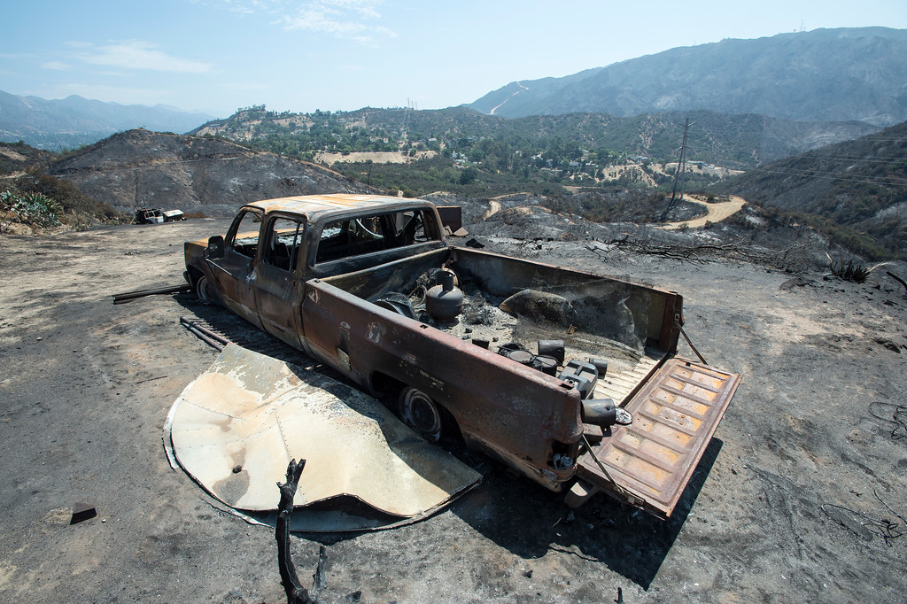 . A destroyed truck sits along the path of the La Tuna Fire on Verdugo Crestline Drive near Tujunga on Tuesday, Sept. 5, 2017. (Photo by Ed Crisostomo, Los Angeles Daily News/SCNG)
