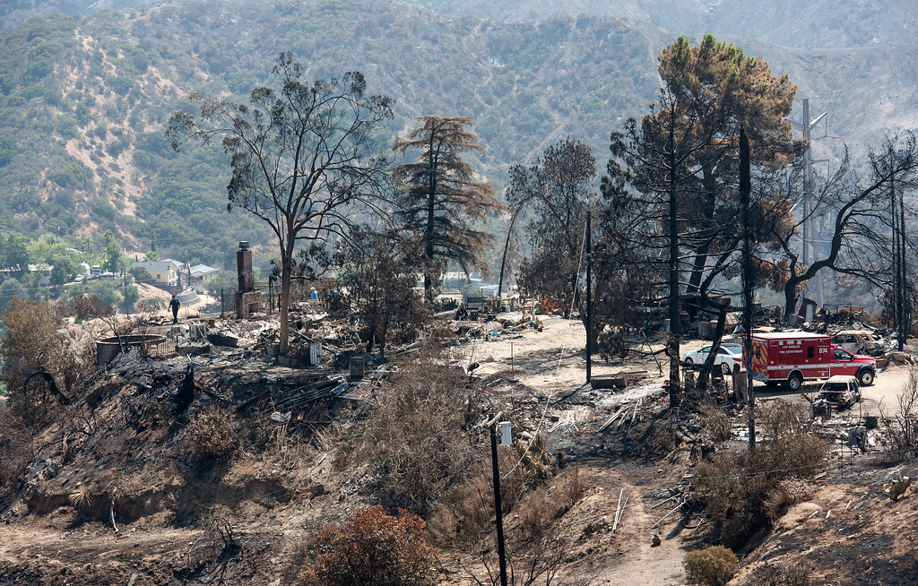 . LAFD crew and staff of the Mayor\'s office check destroyed homes and cars along the path of the La Tuna Fire on Verdugo Crestline Drive near Tujunga on Tuesday, Sept. 5, 2017. (Photo by Ed Crisostomo, Los Angeles Daily News/SCNG)