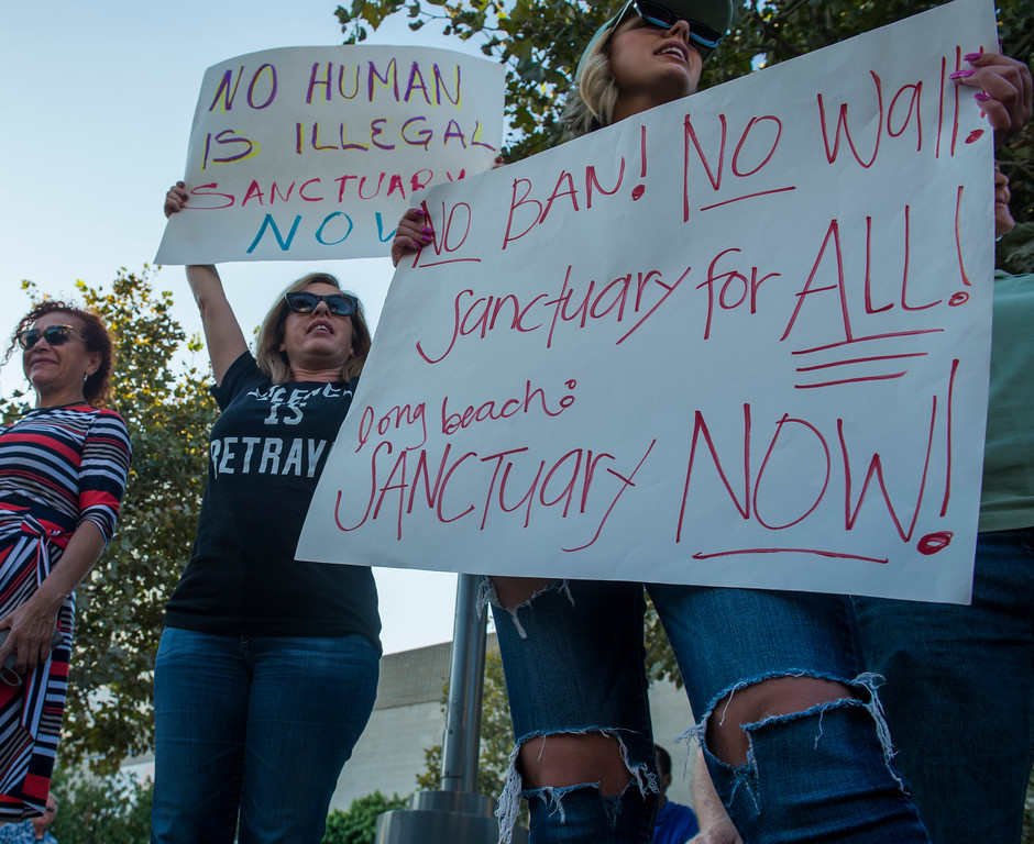 . DACA supporters stand with signs as over 100 people gather along with local community leaders and immigrant rights groups gather at Harvey Milk Park to support and demonstrate at a rally in support of the Deferred Action for Childhood Arrivals (DACA) in Long Beach Wednesday, September 6, 2017. President Donald Trump has rescinded the program, ending amnesty for 800,000 young immigrants brought to the US illegally as minors. (Photo by Thomas R. Cordova, Press-Telegram/SCNG)