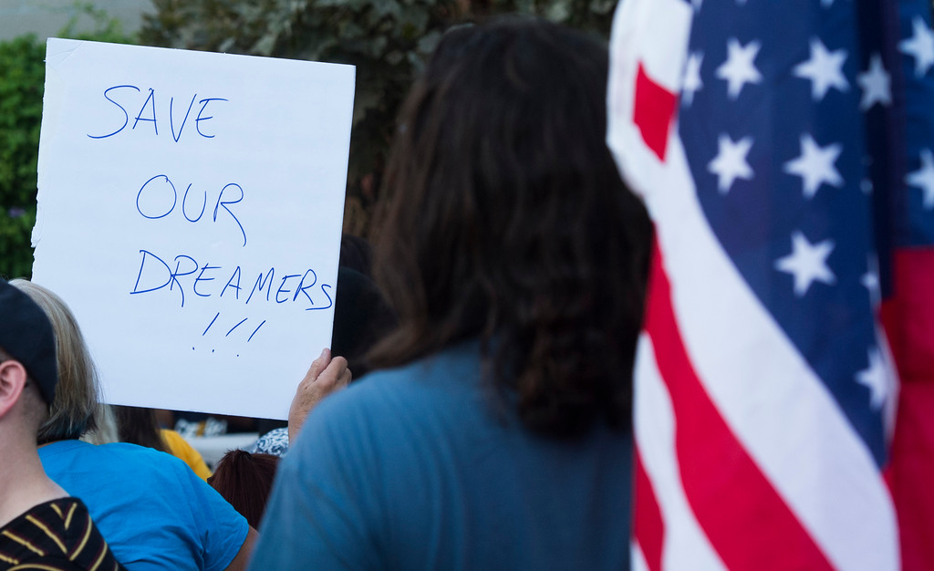 . A man holds an American flag as he and local community leaders and immigrant rights groups gather at Harvey Milk Park to support and demonstrate at a rally in support of the Deferred Action for Childhood Arrivals (DACA) in Long Beach Wednesday, September 6, 2017. President Donald Trump has rescinded the program, ending amnesty for 800,000 young immigrants brought to the US illegally as minors. (Photo by Thomas R. Cordova, Press-Telegram/SCNG)