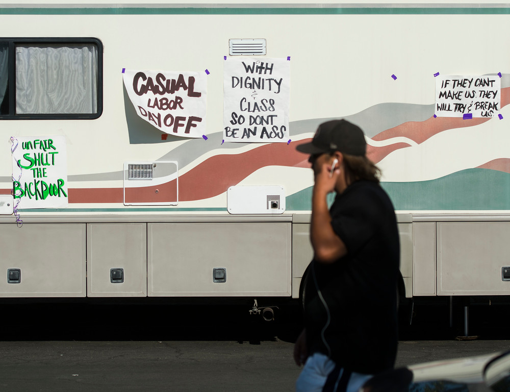 . A man walks past an RV with signs as casuals workers strike outside ILWU hall in Wilmington Friday, September 8, 2017.  Several hundred casuals strike through out the day. (Photo by Thomas R. Cordova, Daily Breeze/SCNG)