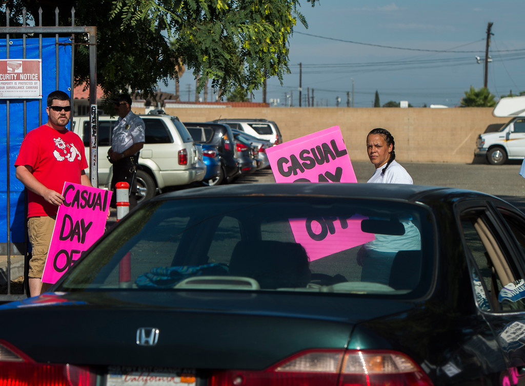 . A casual worker looks at a car drive passing the picket line as casual workers strike outside ILWU hall in Wilmington Friday, September 8, 2017. Several hundred casuals strike through out the day. (Photo by Thomas R. Cordova, Daily Breeze/SCNG)