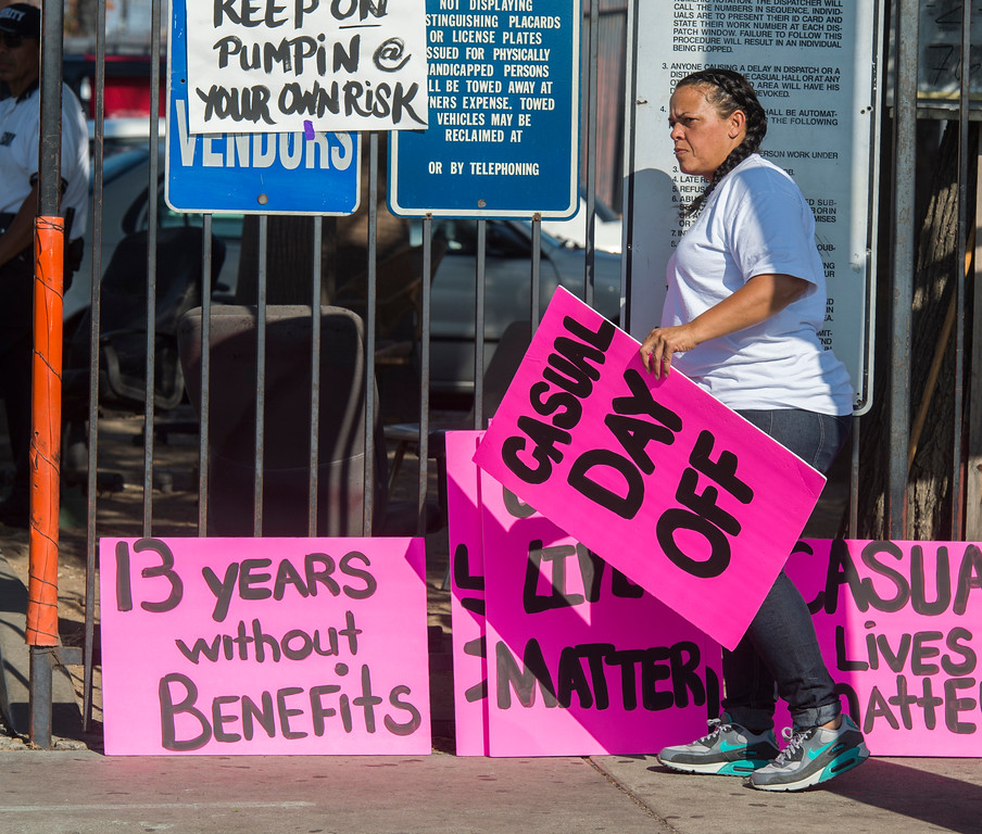 . A casual worker grabs a sign as she walks the picket line as casual workers strike outside ILWU hall in Wilmington Friday, September 8, 2017. Several hundred casuals strike through out the day. (Photo by Thomas R. Cordova, Daily Breeze/SCNG)