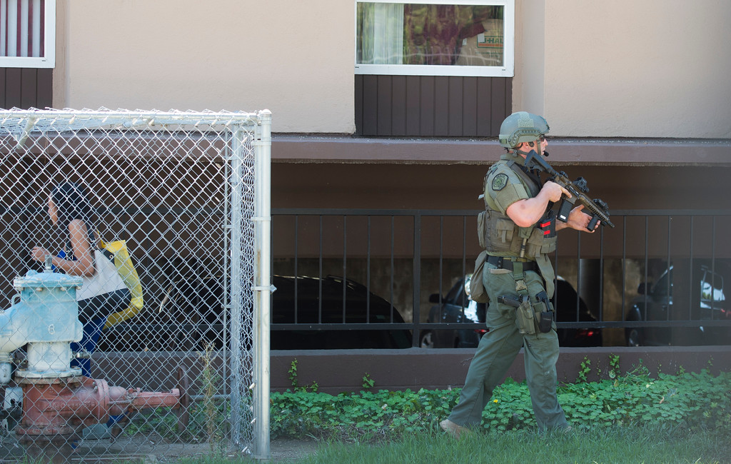 . After 5-hour standoff a suspected gunman surrenders to SWAT officers at an apartment complex on the 5400 block of Paramount Boulevard in Long Beach Monday, September 11, 2017. Police said the 19-year-old was involved in a possible gang shooting Monday morning before he barricaded himself inside the unit.(Photo by Thomas R. Cordova, Press-Telegram/SCNG)