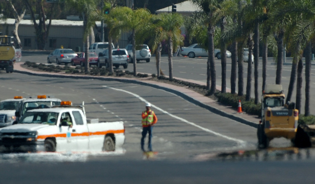. After months of closures Cal Trans crews do the finishing touches on the Seal Beach Boulevard bridge over the 405 freeway which will be open to motorist in Seal Beach Sunday September 15, 2013.  (Photo by Thomas R. Cordova/ Press Telegram)