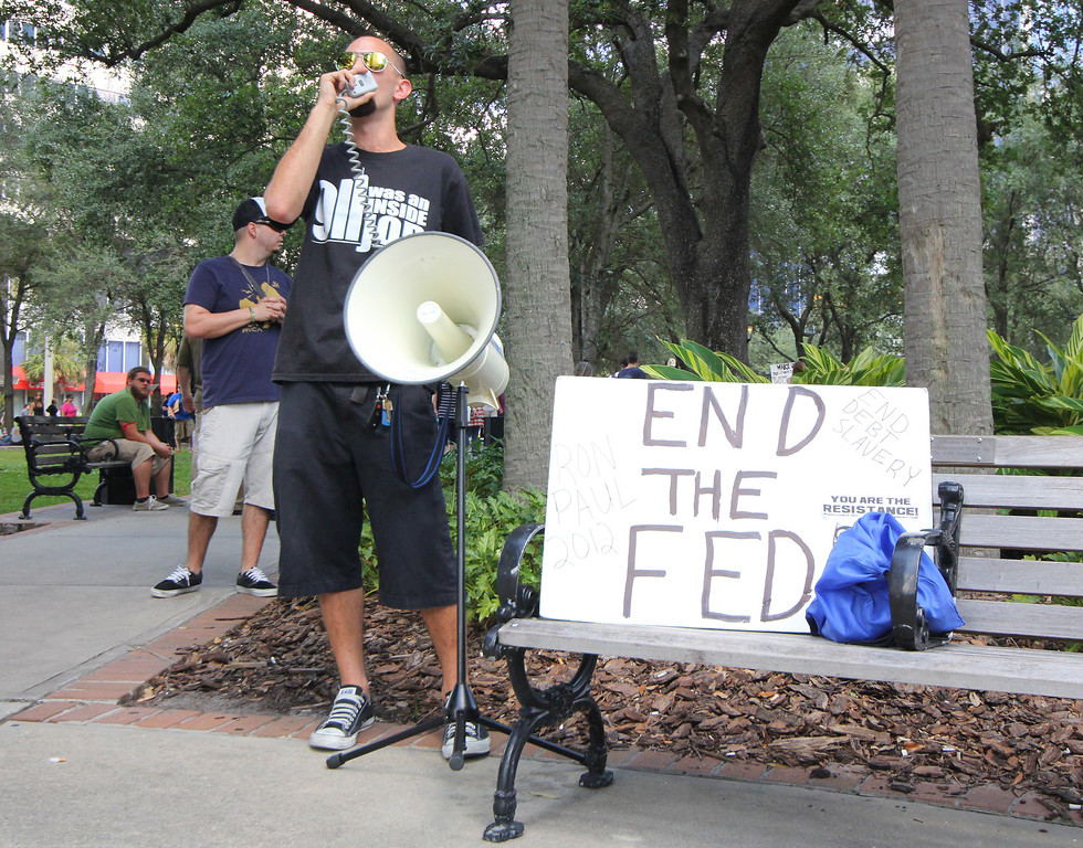 10/6/2011 TAMPA, FL - An unidentified protester uses a megaphone to spread his message during an Occupy Tampa protest. Approximately 500 protesters came out to show support in Tampa, FL  [MANDATORY PHOTO CREDIT: LUKE JOHNSON]