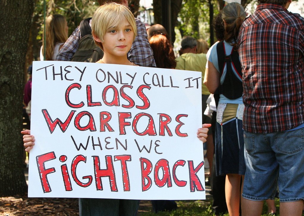 10/6/2011 TAMPA, FL - A young unidentified child holds up a protest sign during an Occupy Tampa protest. Approximately 500 protesters came out to show support in Tampa, FL  [MANDATORY PHOTO CREDIT: LUKE JOHNSON]