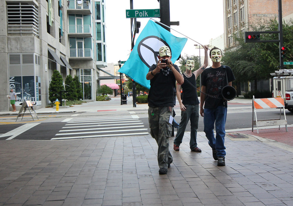 10/6/2011 TAMPA, FL -  Masked Protesters march during an Occupy Tampa protest. Approximately 500 protesters came out to show support in Tampa, FL  [MANDATORY PHOTO CREDIT: LUKE JOHNSON]