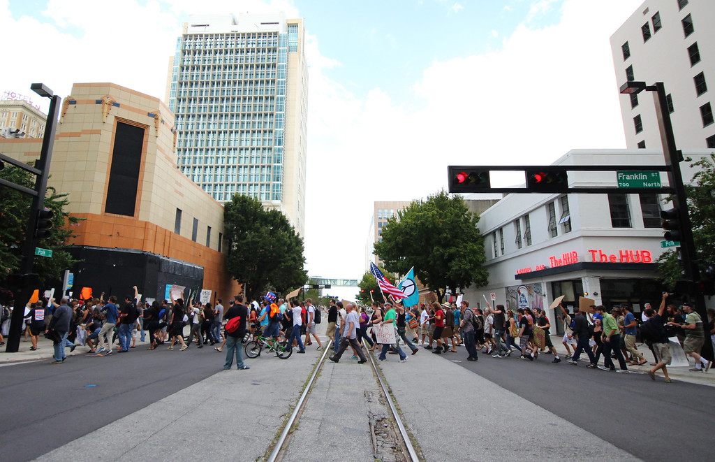 10/6/2011 TAMPA, FL - Protesters march across the street during an Occupy Tampa. Approximately 500 protesters came out to show support in Tampa, FL  [MANDATORY PHOTO CREDIT: LUKE JOHNSON]