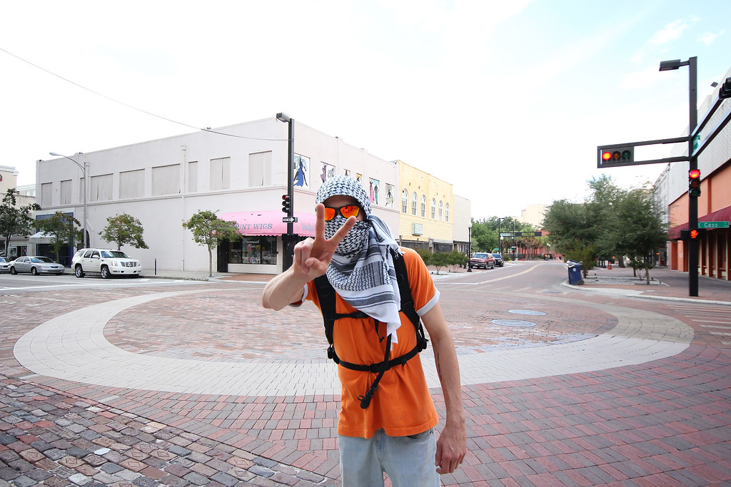 10/6/2011 TAMPA, FL - A masked protester makes a peace sign during an Occupy Tampa protest. Approximately 500 protesters came out to show support in Tampa, FL  [MANDATORY PHOTO CREDIT: LUKE JOHNSON]