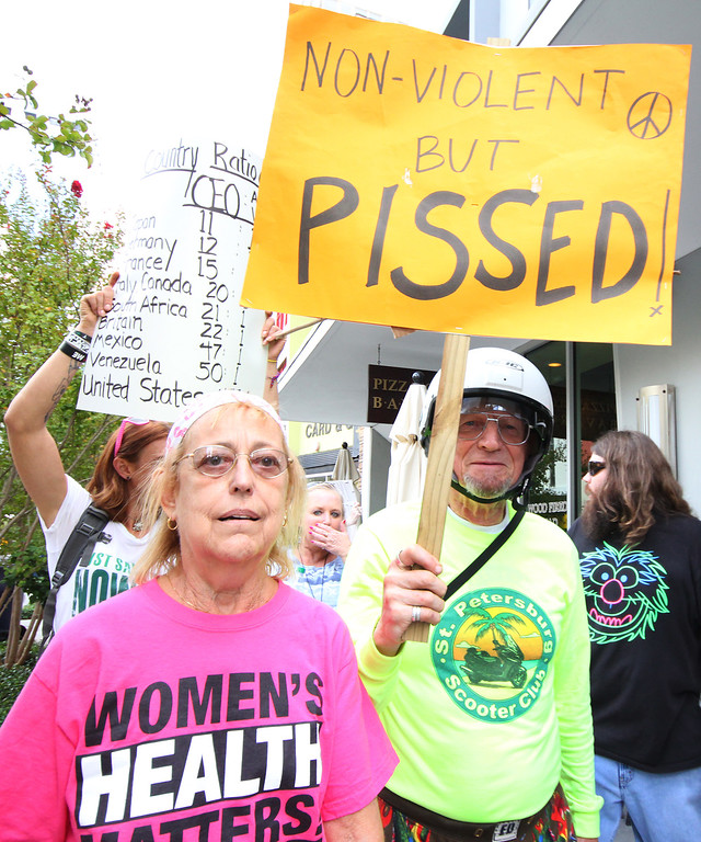 10/6/2011 TAMPA, FL -  Unidentified protesters march during an Occupy Tampa. Approximately 500 protesters came out to show support in Tampa, FL  [MANDATORY PHOTO CREDIT: LUKE JOHNSON]