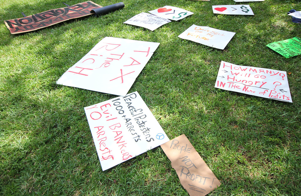 10/6/2011 TAMPA, FL - Protest signs lay on the grass during an Occupy Tampa protest. Approximately 500 protesters came out to show support in Tampa, FL  [MANDATORY PHOTO CREDIT: LUKE JOHNSON]