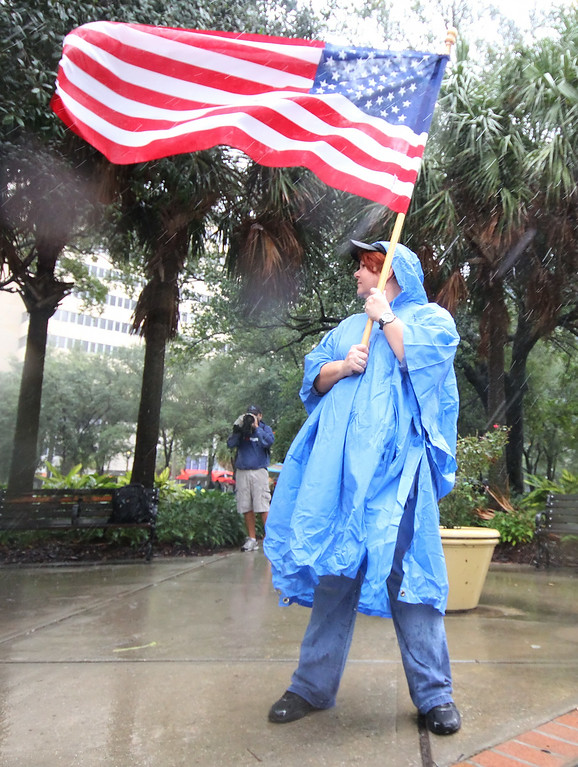 10/9/2011 TAMPA, FL - A protester waves an american flag during an Occupy Tampa protest in Tampa, FL. [MANDATORY PHOTO CREDIT: LUKE JOHNSON]