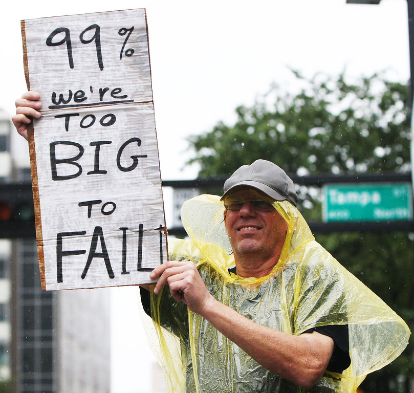 10/9/2011 TAMPA, FL - An unidentified protester stands in the rain during an Occupy Tampa protest in Tampa, FL. [MANDATORY PHOTO CREDIT: COURTLAND SAMUELS]